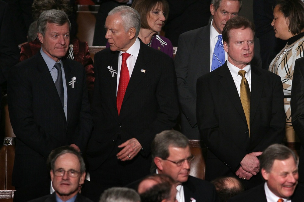 Sen. Orrin Hatch (R-UT), center, talks with Sen. Max Baucus (D-MT), left, as Sen. Jim Webb (D-VA) takes in the scene before the State of the Union address.