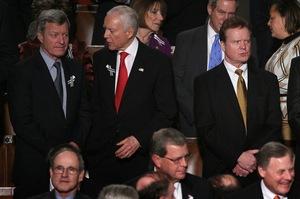 Montana Democratic Sen. Max Baucus (from left) talks with Sen. Orrin Hatch (R-UT) as Sen. Jim Webb (D-VA) looks on before the speech.