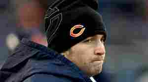 Chicago Bears quarterback Jay Cutler stands on the sideline in the third quarter after leaving the game with an injury against the Green Bay Packers on Sunday. His decision to sit out of the remainder of the game, which Chicago lost, made Cutler the target of critical Tweets from his peers in the National Football League.