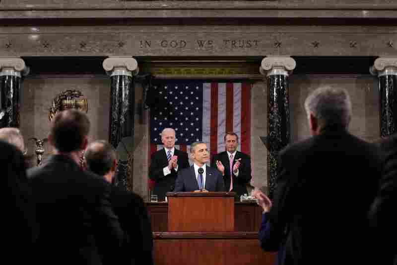 With Vice President Joe Biden and House Speaker John Boehner behind him, President Obama delivers his State of the Union speech Tuesday to a joint session of Congress on Capitol Hill.