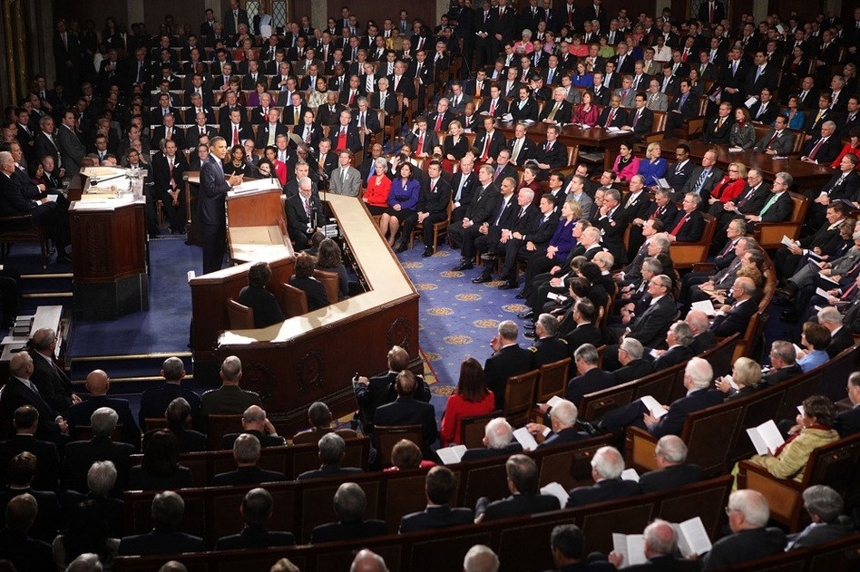 For the first time in memory, many members of Congress sit beside colleagues from the opposite political party.  (AP)