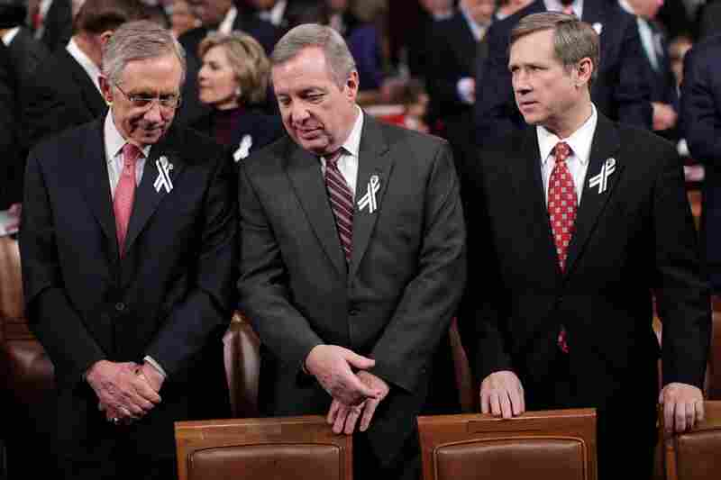 Senate Majority Leader Harry Reid (D-NV) and Senate Majority Whip Richard Durbin (D-IL) chat as they stand with Sen. Mark Kirk (R-IL).
