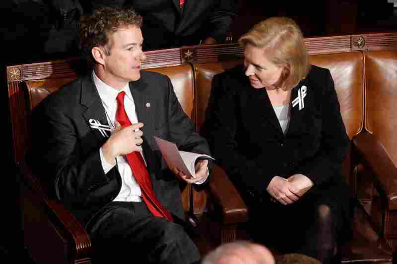 Sen. Rand Paul (R-KY), left, and Sen. Kirsten Gillibrand (D-NY) talk before President Obama takes the stage.