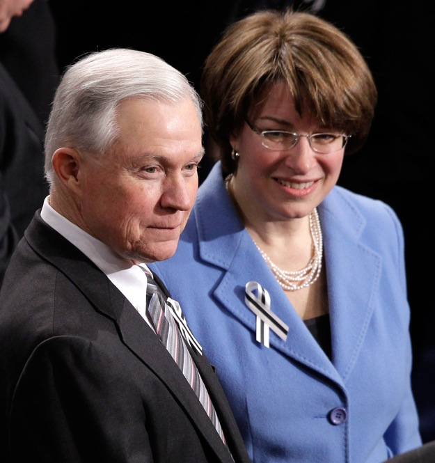Sen. Jeff Sessions (R-AL) and Sen. Amy Klobuchar, (D-MN) prepare to sit together.