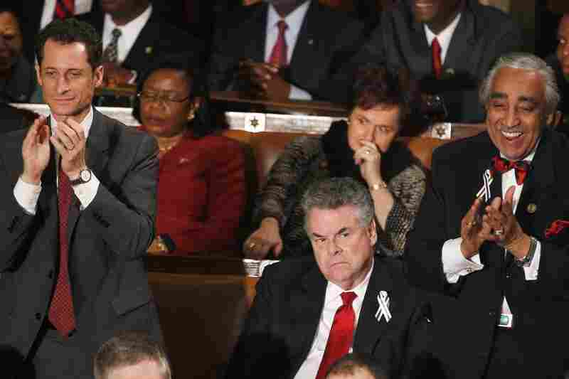 Rep. Peter King (R-NY), center, finds little to enjoy as Rep. Anthony Weiner (D-NY), left, and Rep. Charles Rangel, (D-NY), right, applaud during President Barack Obama's State of the Union address. King and Anthony Weiner screamed at each other on Fox New last summer.