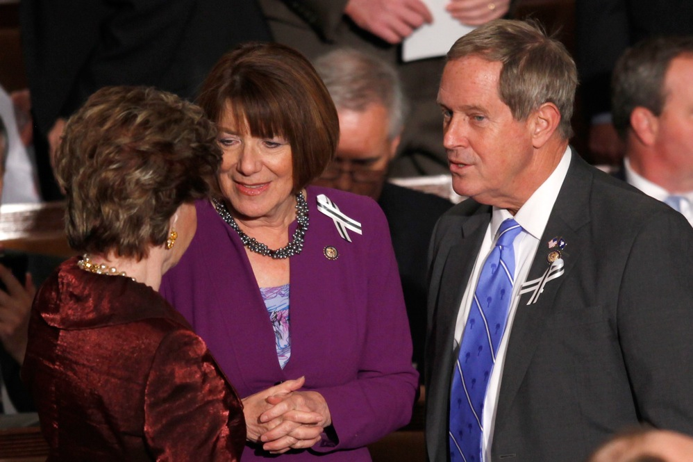 Rep. Joe Wilson (R-SC), right, talks with Del. Madeleine Bordallo (D-Guam), left, and Rep. Susan Davis, (D-CA).