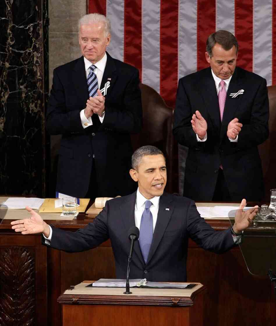 Vice President Biden and Speaker Boehner applaud as President Obama gestures before speaking.