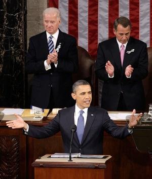 Vice President Biden and Speaker Boehner applaud as President Obama gestures before speaking.
