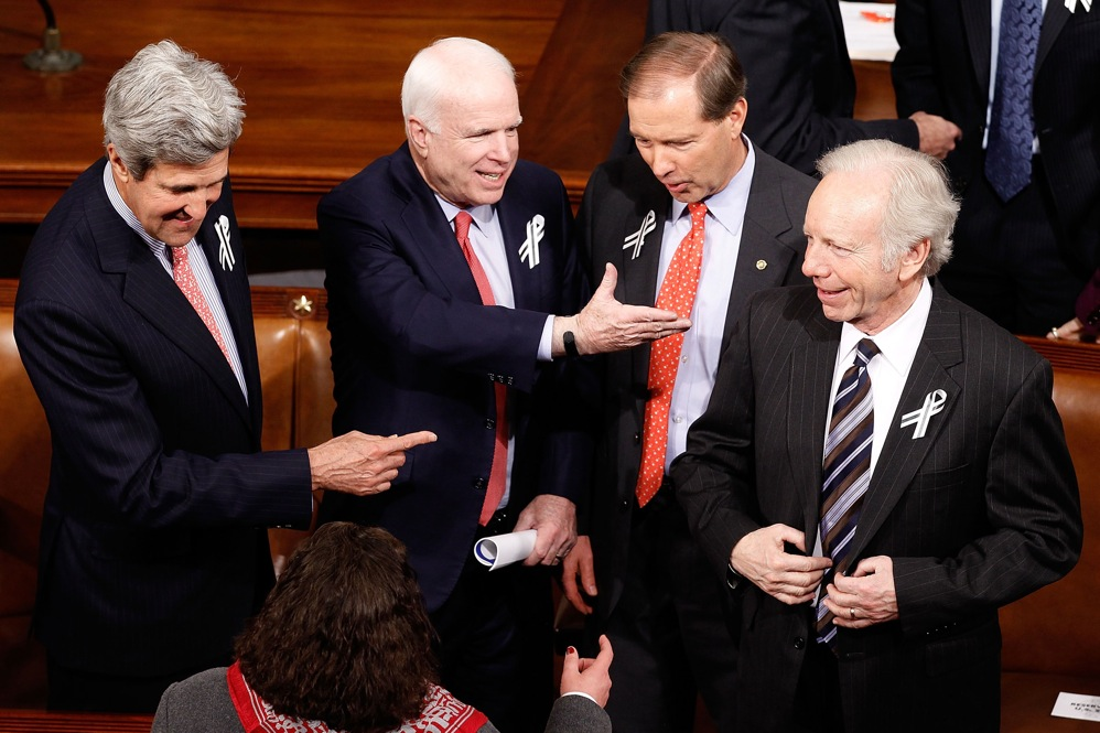 Former presidential contenders Sen. John Kerry (D-MA), Sen. John McCain (R-AZ) and Sen. Joe Lieberman (I-CT), far right, talk with Sen. Mark Udall (D-CO), center right.