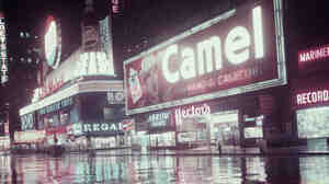 A neon sign for Camel cigarettes near Times Square in New York City, circa 1958.