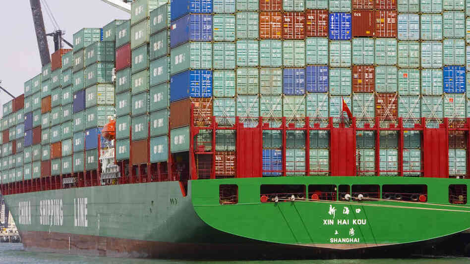 Containerized cargo is stacked high on a China Shipping Line freighter in 2006 in Miami Beach, Florida. Despite China's growing economy, author Daniel Altman believes cultural and demographic factors will prevent it from overtaking the United States as an economic power.