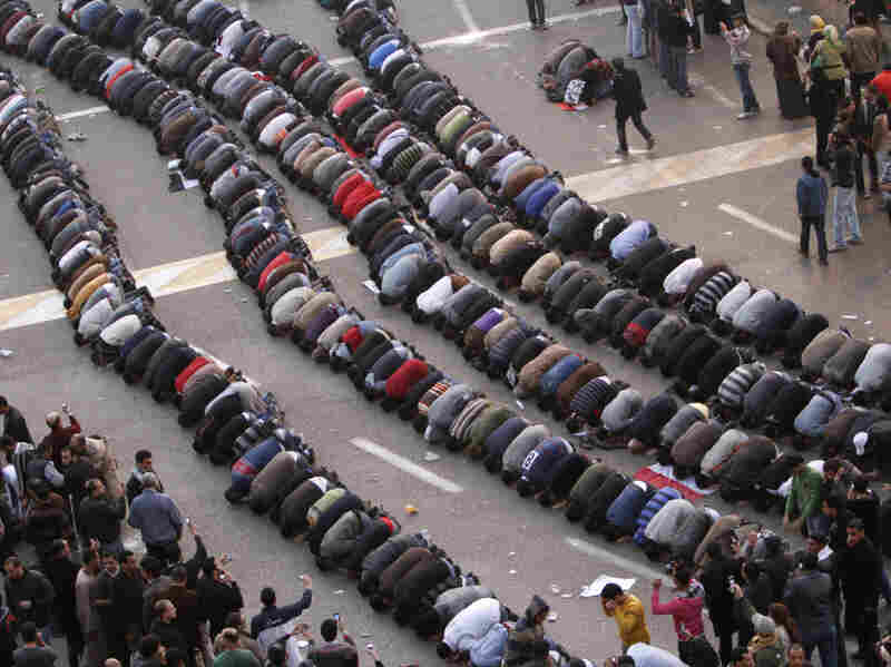 Demonstrators pray Tuesday in central Cairo during a protest to demand Mubarak's ouster.