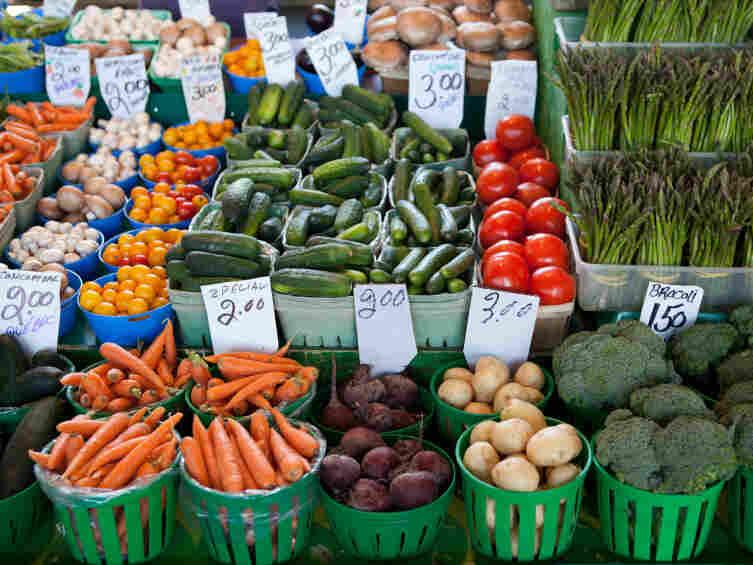 Fresh produce piled high at a farmers' market.