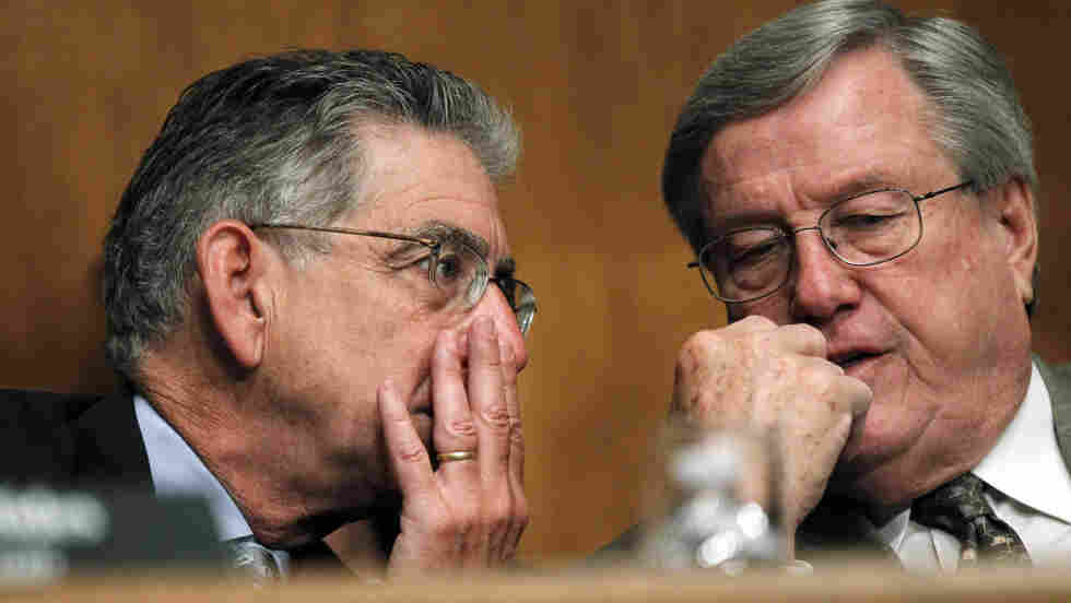 The FCIC's Democratic chairman (left) and Republican vice chairman can't agree on what caused the crisis.