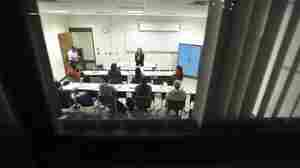 Students gather in a night class at Bunker Hill Community College in Boston