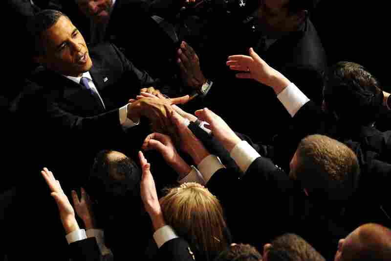 Obama is greeted following the address.