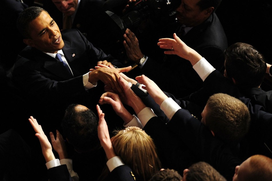 Obama is greeted following the address.  (AFP/Getty Images)