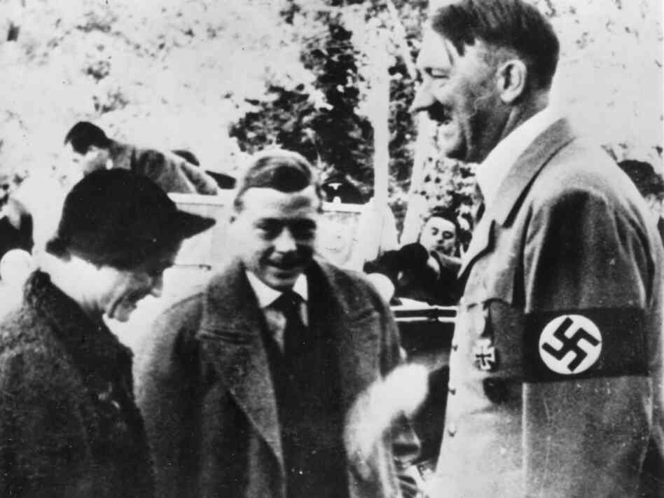 The erstwhile Edward VIII, Duke of Winsdor, and his Duchess, Wallis Simpson, meeting Adolf Hitler in Germany.  In 1937.  A year before Kristallnacht.