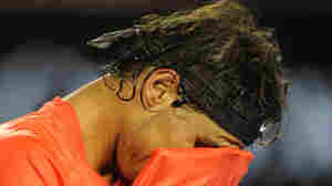 Rafael Nadal of Spain wipes his face with his shirt during the final set against David Ferrer of Spain in their quarter-final men's singles match today in Melbourne.