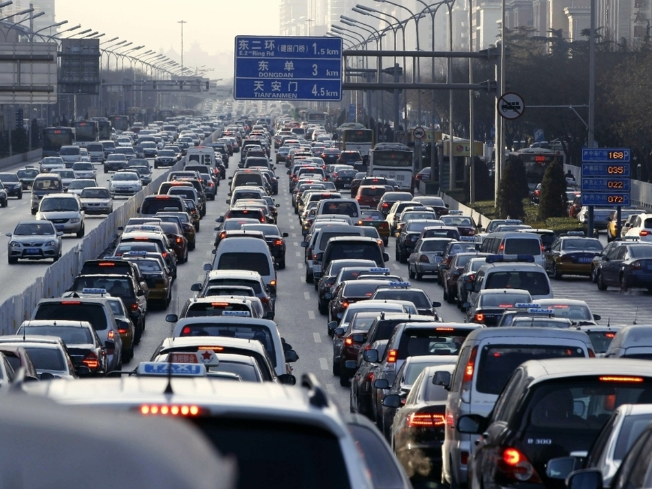 Vehicles sit in a traffic jam during a  weekday rush hour earlier this month in Beijing, which has been ranked among the world's most gridlocked cities. Beijing authorities' latest effort to cut the number of vehicles on the roads — a license plate lottery — has been met with criticism from auto dealers and some residents.