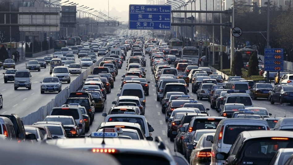 Vehicles sit in a traffic jam during a  weekday rush hour earlier this month in Beijing, which has been ranked among the world's most gridlocked cities. Beijing authorities' latest effort to cut the number of vehicles on the roads — a license plate lottery — has been met with criticism from auto dealers and some residents. (AFP/Getty Images)