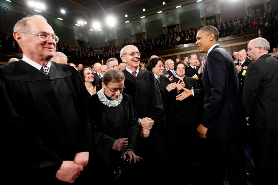 Obama greets Supreme Court justices Anthony Kennedy (from left), Ruth Bader Ginsburg, Stephen Breyer, Sonia Sotomayor and Elena Kagan.  (AP)