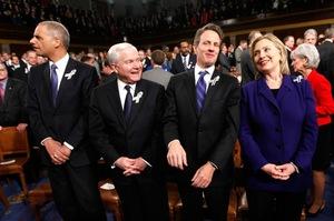 Attorney General Eric Holder (from left), Defense Secretary Robert Gates, Treasury Secretary Tim Geithner and Secretary of State Hillary Clinton await Obama's address.