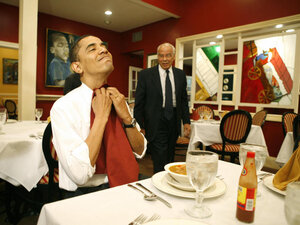 Then-Senator Obama puts on a napkin before eating a gumbo with Chairman of Louisiana Recovery Authority Dr Norman Francis during his visit in Louisiana ahead of the state's primary in 2008. Now president, Obama delivered his State of the Union speech on Tuesday night.