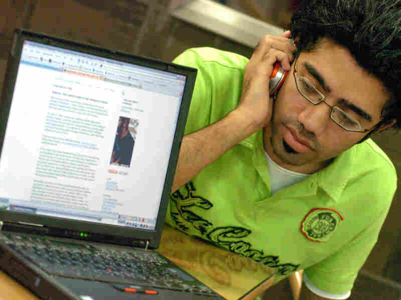 Ahmed al-Omran, a 22-year-old Saudi university student, checks his Internet blog  on his laptop computer at a cafe in Riyadh, Saudi Arabia, on June 5, 2006.