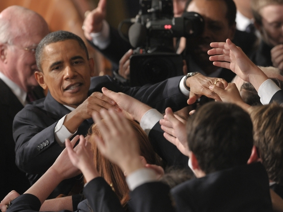 President Barack Obama greets Congressional pages after delivering the State of the Union address. (AFP/ Getty Images)