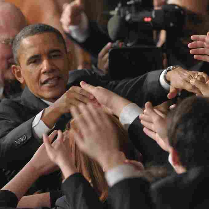 President Barack Obama shakes hands with Congressional pages after delivering the State of the Union address.