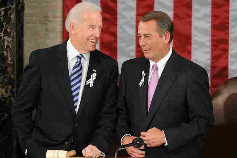 Biden and Boehner wear black-and-white ribbons in honor of the Arizona shooting victims.