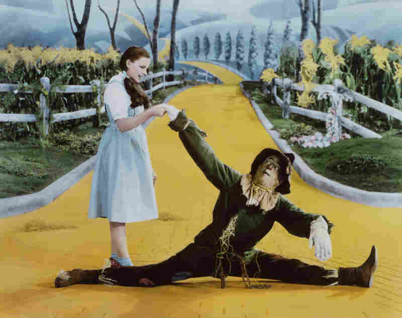 Dorothy and the scarecrow on the Yellow Brick Road, in a scene from the 1939 film 'The Wizard of Oz.'