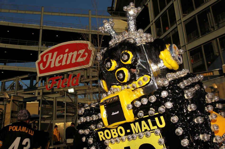 A fan dressed as Robo-Malu, inspired by Troy Polamalu of the Pittsburgh Steelers, waits for the AFC Championship game between the New York Jets and the Steelers on January 23, 2011.