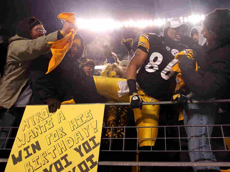 Hines Ward of the Pittsburgh Steelers climbs into the stands to celebrate with fans after their win over the New York Jets in the AFC Championship game.