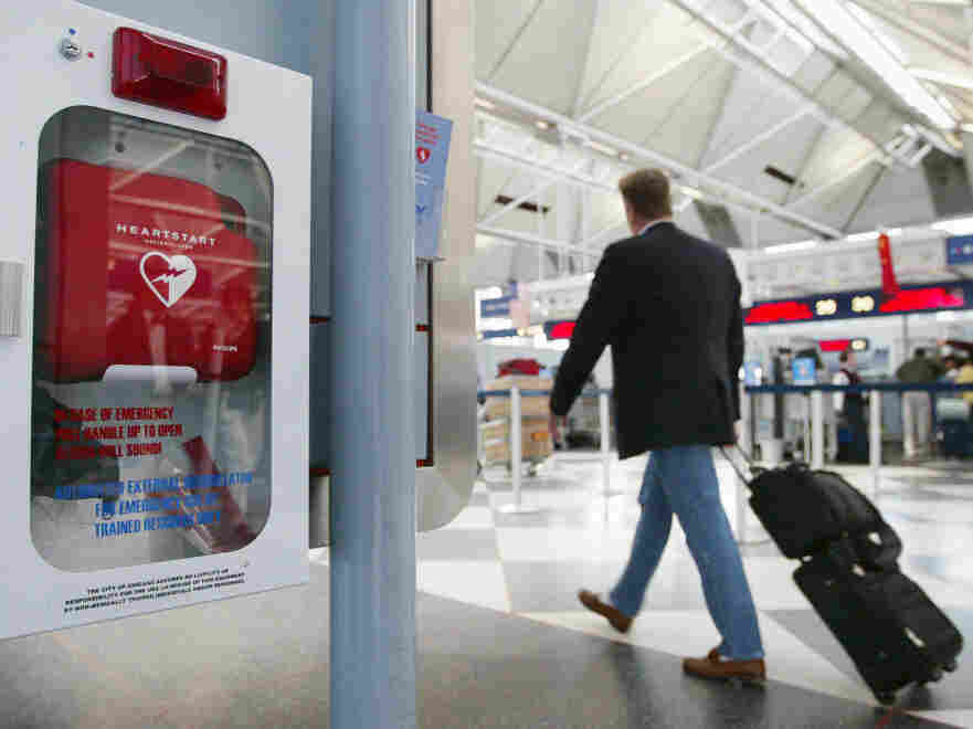 A traveler passes an automated external defibrillator at O'Hare International Airport in Chicago.