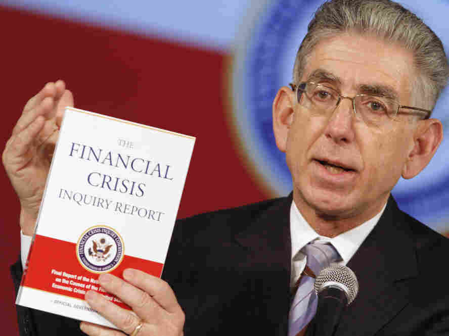 Financial Crisis Inquiry Commission Chairman Phil Angelides with the official commission report.