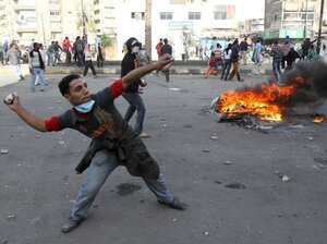 Egyptian demonstrators throw stones at Egyptian police during demonstration in Suez demanding the ouster of President Hosni Mubarak. Mubarak has been ruling the country for nearly three decades, and is expected to pass the presidency to his son, Gamal.