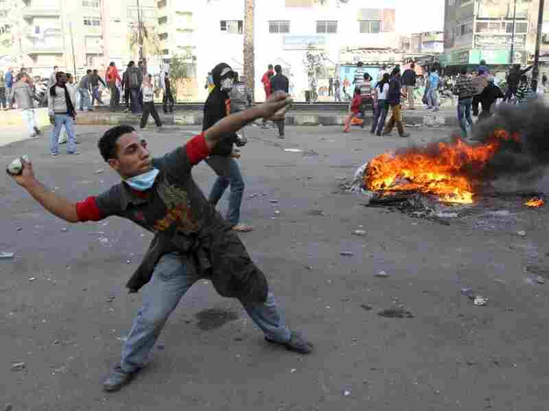 Egyptian demonstrators throw stones at Egyptian police during demonstration