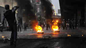 A demonstrator threw an object towards police during a protest Wednesday (Jan. 26, 2011) in Cairo.