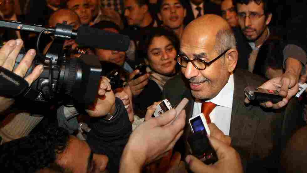 Mohamed ElBaradei was surrounded by reporters as he arrived at Cairo airport today (Jan. 27, 2011).