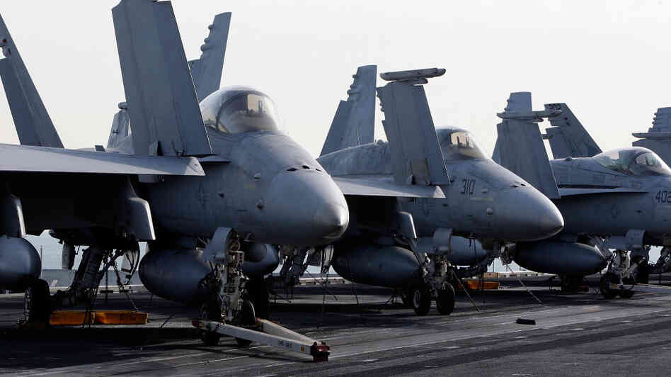 F-18 Super Hornets on the aircraft carrier USS Carl Vinson.