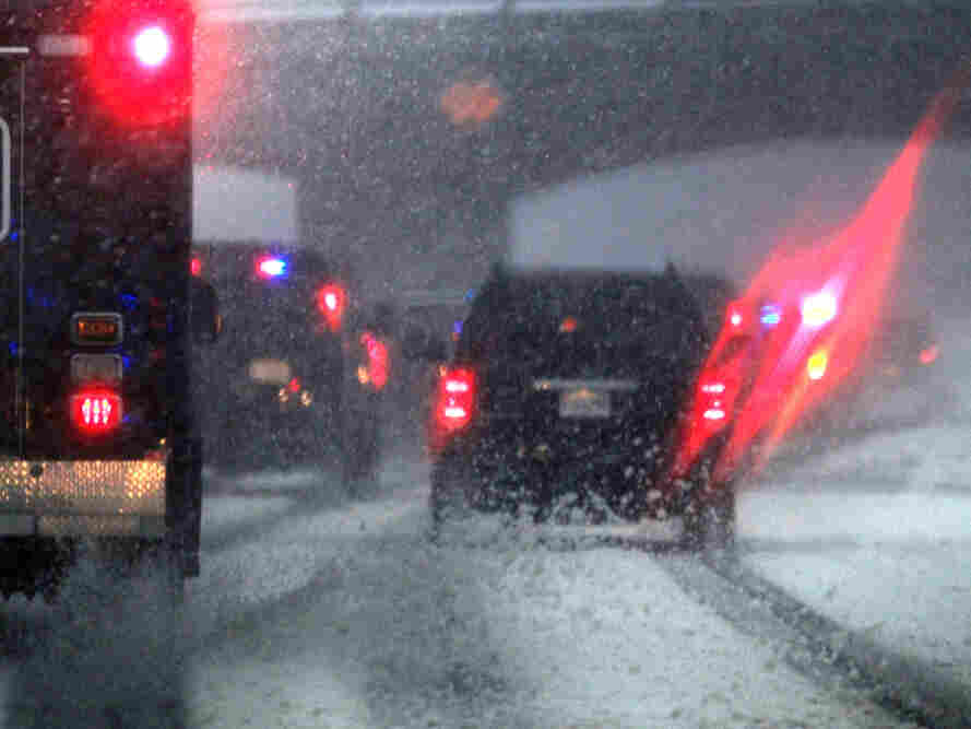 President Obama's motorcade heads through a snowstorm to the White House, Wednesday, Jan. 26, 2011
