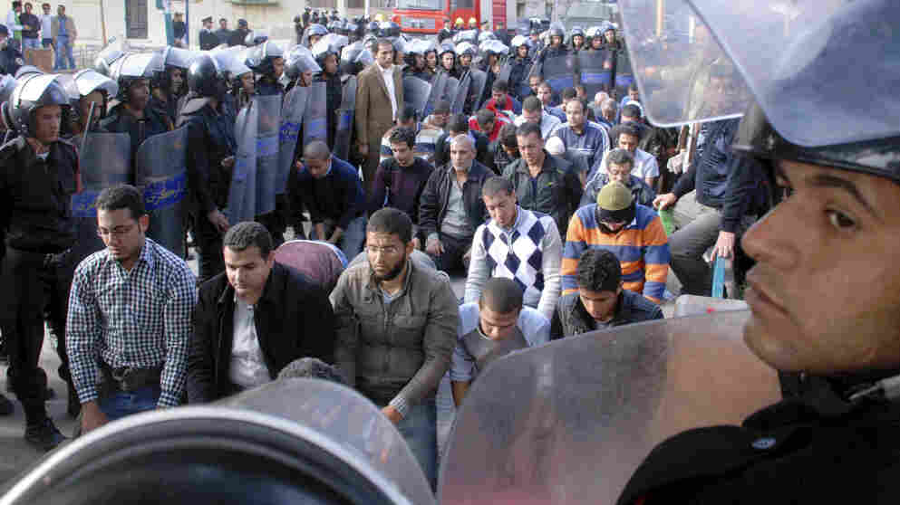 Egyptian riot police surrounded some praying protesters in Suez today (Jan. 27, 2011).