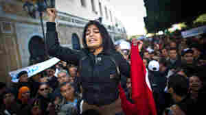 A woman participates in a demonstration in Tunis on January 22, 2011.