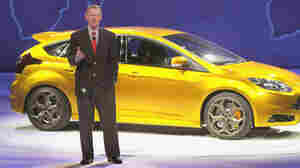 Ford CEO Alan Mulally, pictured with the 2011 Ford Focus, is credited with turning around the company. But analysts say the automaker still faces formidable challenges ahead.