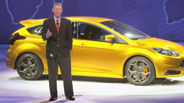 Ford CEO Alan Mulally, pictured with the 2011 Ford Focus, is credited with turning the company around. But analysts say the automaker still faces formidable challenges ahead.