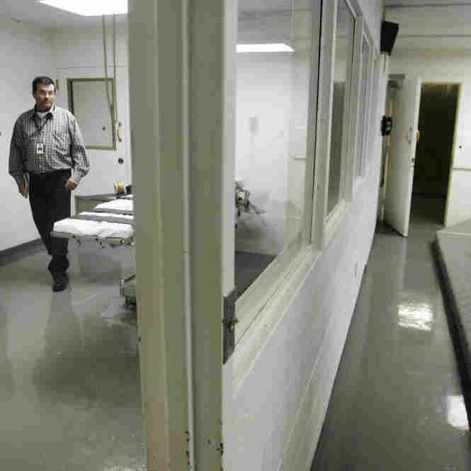 In this April 2008 photo, Terry Crenshaw, warden's assistant at the Oklahoma State Penitentiary, walks past the gurney in the execution chamber in McAlester, Okla. Oklahoma is one of the few states that use pentobarbital in the lethal injection procedure.