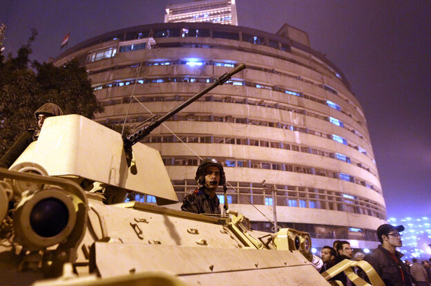 President Hosni Mubarak's Republican Guard deploy outside the national television building in Cairo.