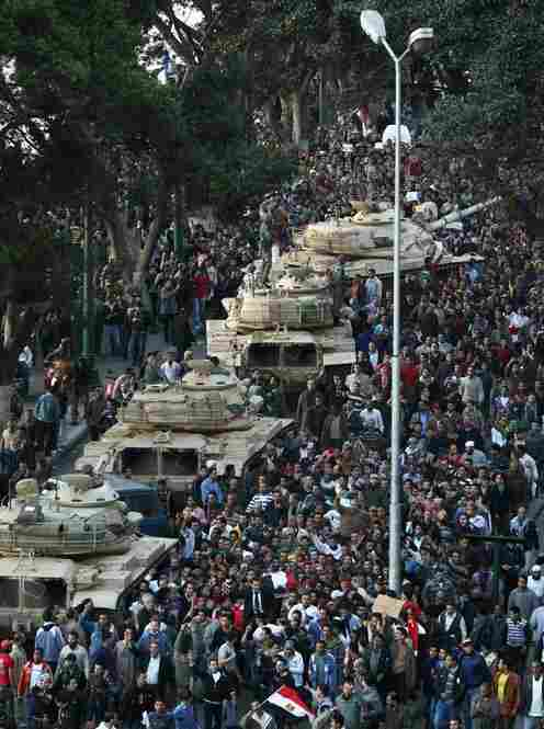 Tanks sit among the crowd in Cairo on Saturday.